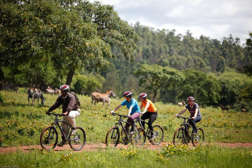 Bikers in Mlilwane Wildlife Sanctuary. You can also bike in Hlane Royal National Park and Mkhaya Game Reserve