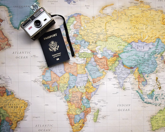 African Travel Guide: map of Africa with passport and camera