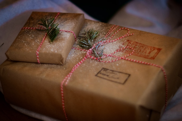 An image of a wrapped gifts in a repurposed brown grocery bag in African Christmas in Chad