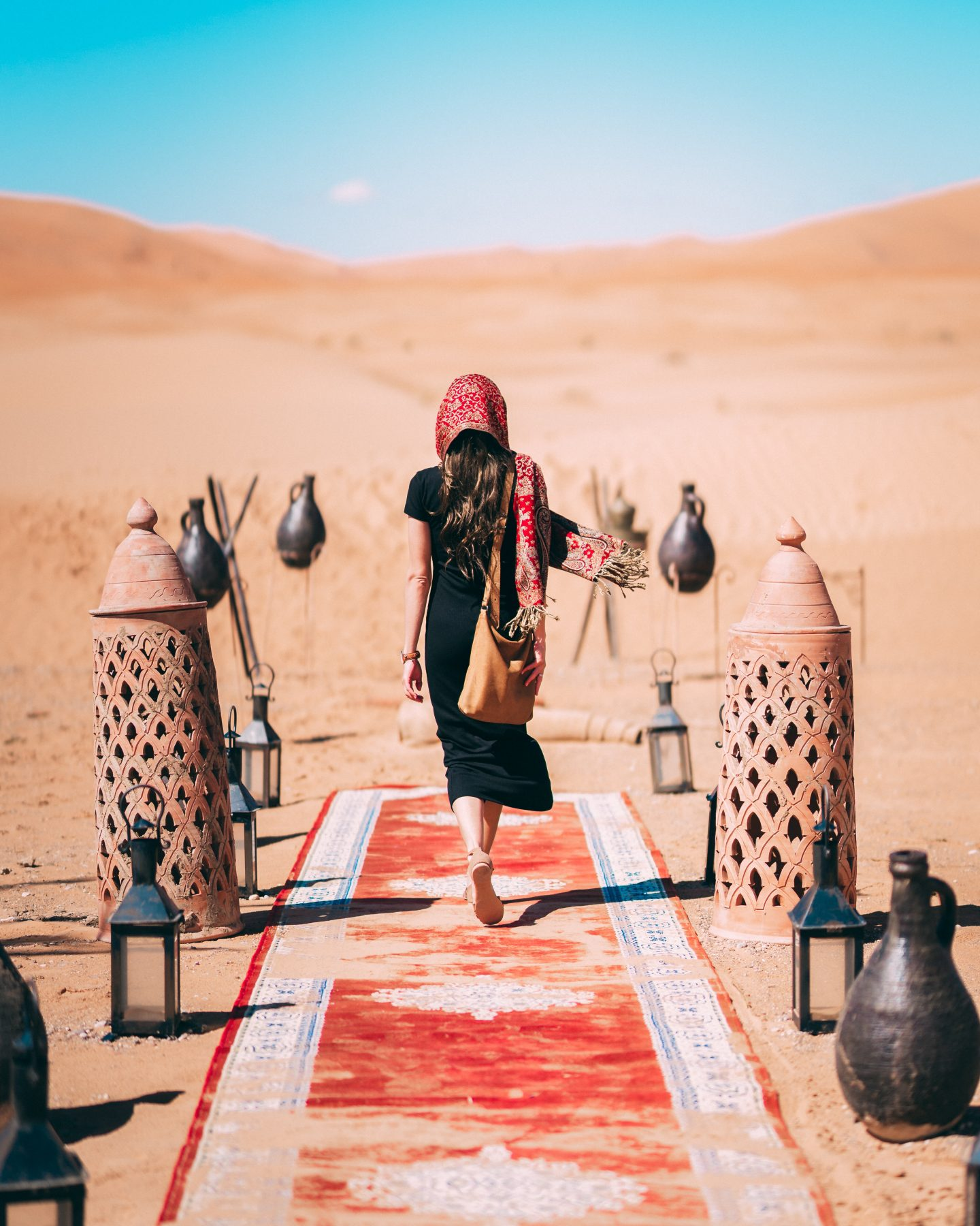 A tourist touring the desert wearing  essential egypt packing list items
