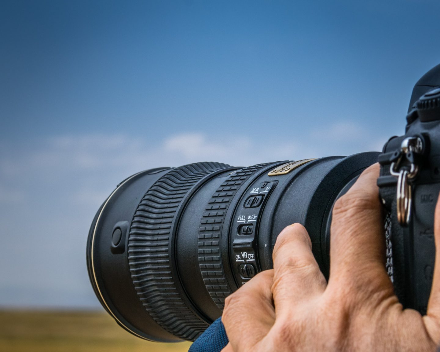 A man using one of the best camera for safari for an image