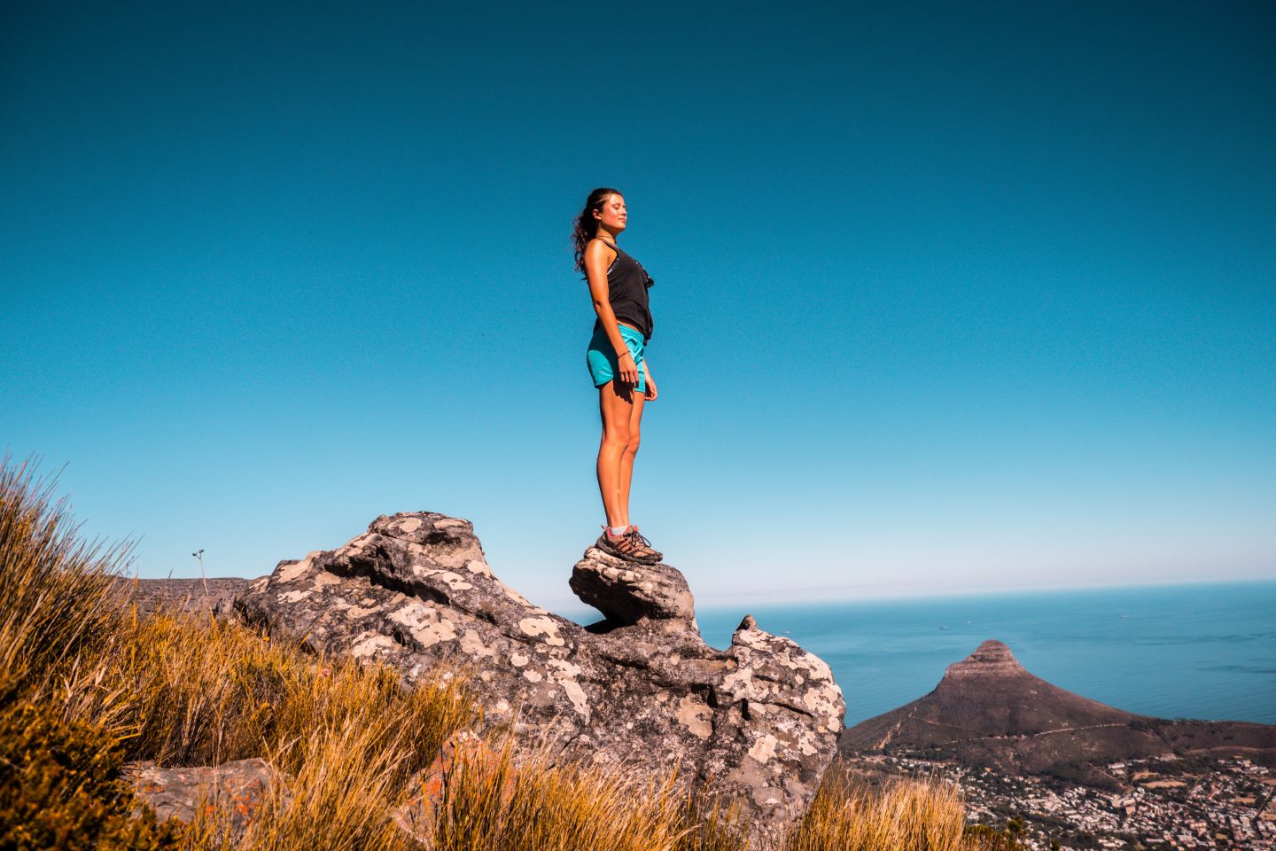 Woman with her hiking gear, a must-have for your south africa packing list